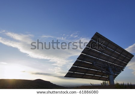 view of a large solar panel for renewable electric energy production - stock photo