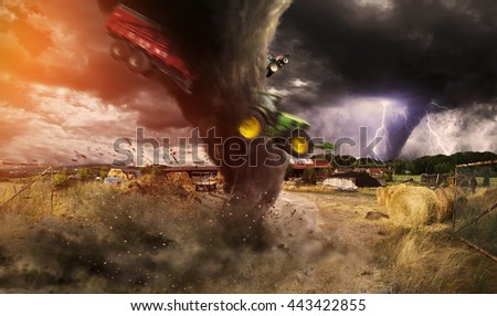 View of a large tornado destroying a barn - stock photo