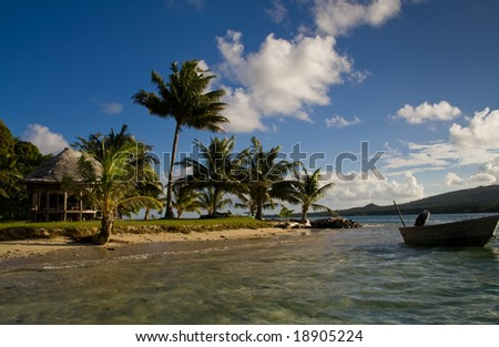view of a little island in samoa with a boat