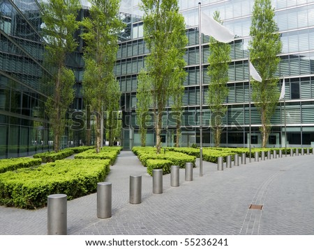 view of a little public park in a modern city near the skyscrapers - stock photo