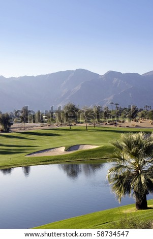 View of a lush golf course - stock photo