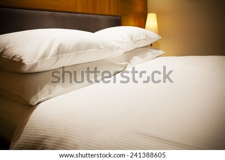 View of a luxurious hotel room with double bed