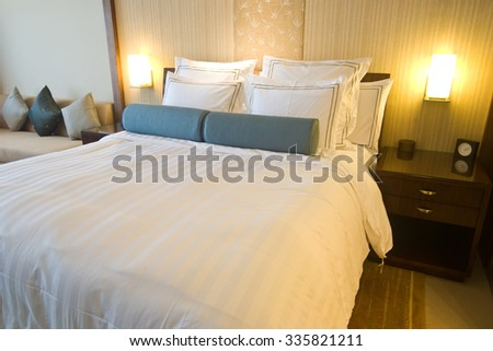 View of a luxurious hotel room with king bed