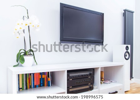 View of a modern white living room equipment with TV and Stereo - stock photo