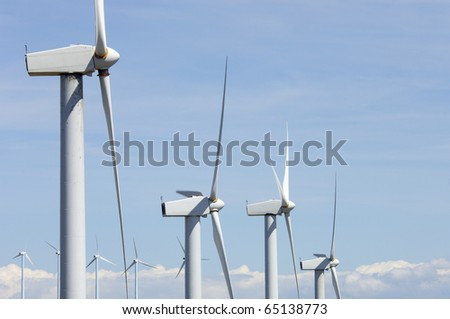 view of a modern windmills with cloudy sky - stock photo