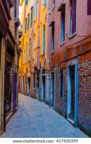 view of a narrow brick street in italian city venice - stock photo