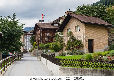 View of a neighbourhood in Swiss Alps near Klosters Disentis. - stock photo