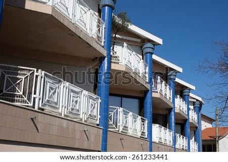 View of a  newly built modern block of flats under blue sky  - stock photo