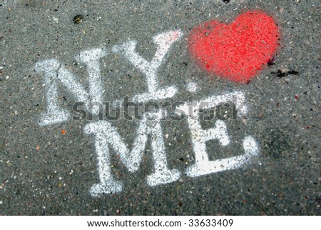 View of a nice text graffiti on the pavement. - stock photo