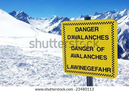 View of a notice board showing a danger of avalanches. - stock photo