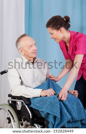 View of a nurse caring about disabled man