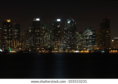 View of a partial skyline of San Diego, California from the water at night - stock photo
