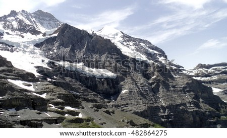 View of a peak in the Alps around the  Kleine Scheidegg on the Jungfrau railway to Jungfraujoch in Switzerland