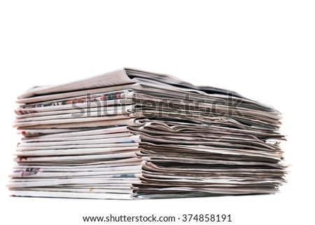 View of a pile of newspapers stacked isolated on a white background. - stock photo