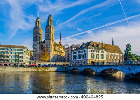 view of a quay of river limmat in the swiss city zurich which is dominated by the town hall on one side and grossmunster cathedral on the other