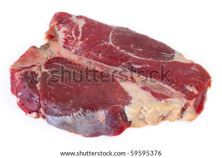 View of a raw T-bone or porterhouse steak isolated on white seen from an angle. - stock photo