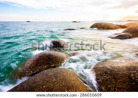 view of a rocky coast in sunset - stock photo