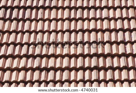 view of a roof with red tiles structure