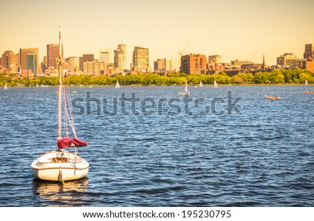 View of a sailboat on the Charles River in Boston at sunset - stock photo