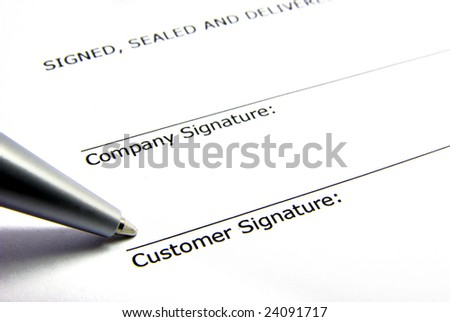 View of a signature box of a contract with a pen.