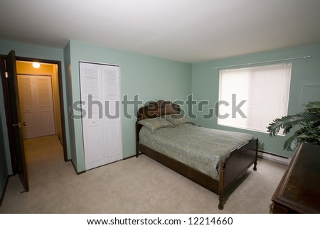 View of a simple bedroom in a condo - stock photo