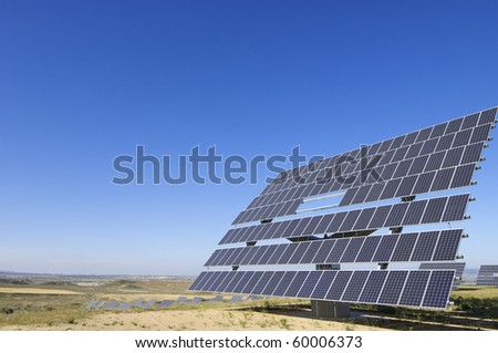 view of a solar field of renewable electricity production - stock photo
