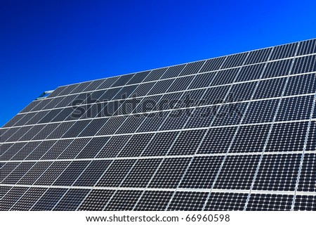 View of a solar panel against a blue sky