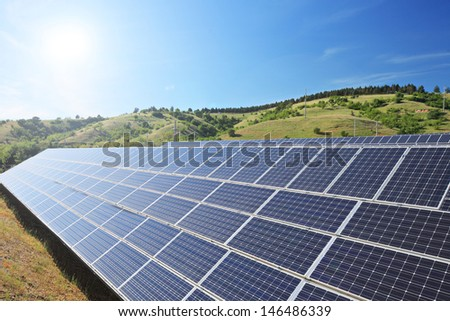 View of a solar photovoltaic cell panels under sunny sky - stock photo