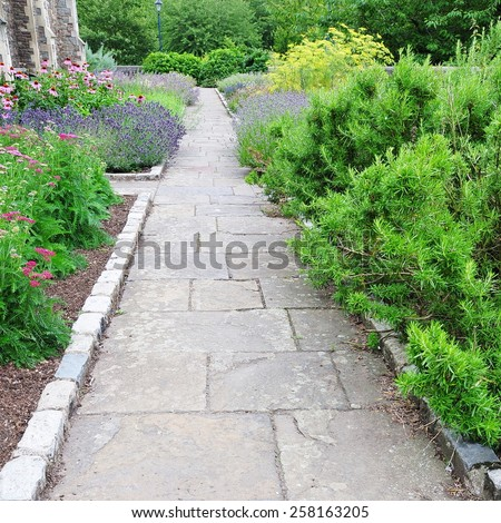 View of a Stone Paved Garden Path - stock photo