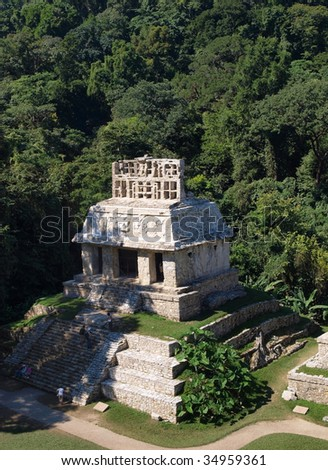 View of a temple in the ruins of the ancient Mayan city of Palenque, Mexico. - stock photo