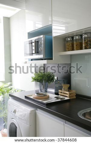 view of a tiny condominium kitchen