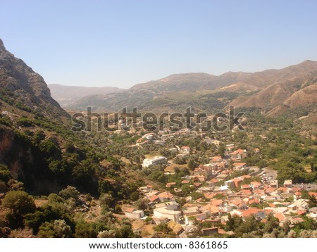 View of a town in Crete nestled in between mountains.