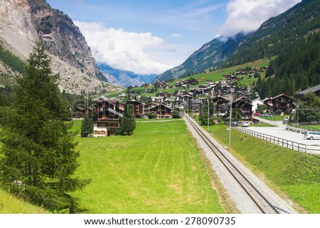 View of a track and valley in Switzerland Alps near Zermatt and Tasch - stock photo