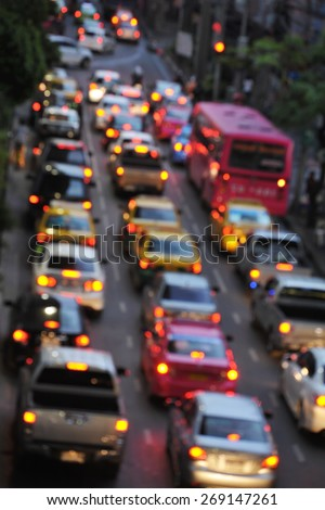View of a Traffic Jam on a City Road During Evening Rush Hour - Image Has Soft Focus - stock photo