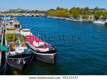 View of a two living barge on the Seine in Paris. France - stock photo