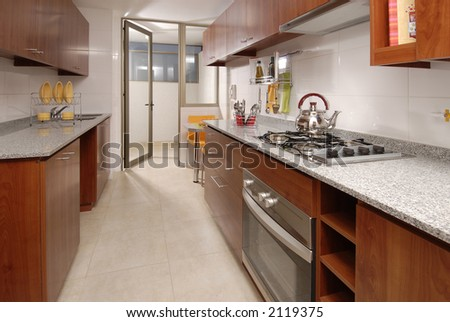 view of a typical apartment kitchen - stock photo