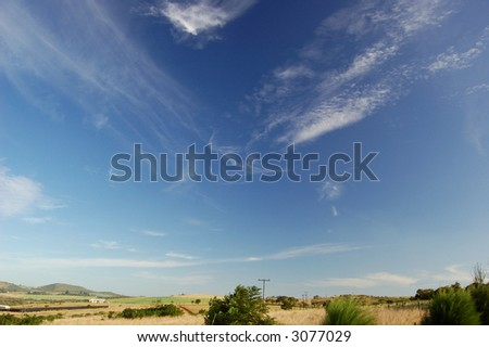 View of a valley with a polarized sky - stock photo
