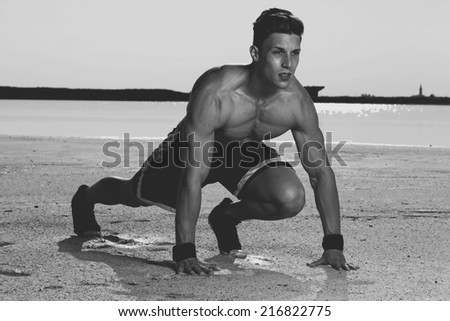 View of a very fit male model with muscles. - stock photo