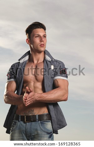 View of a very fit male model with muscles.Fashion photo.