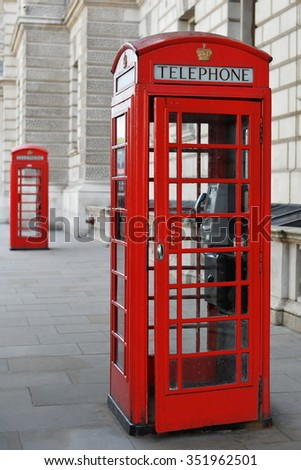 View of a Vintage Red British Phone Box on a Central London Street - stock photo