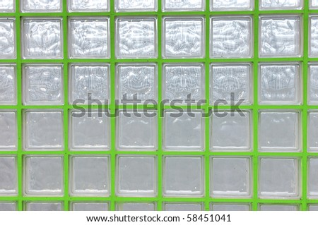 view of a wall consisting of glass cubes photographed backlit - stock photo