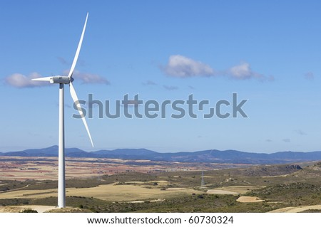 view of a windmill on a pleasant summer morning - stock photo