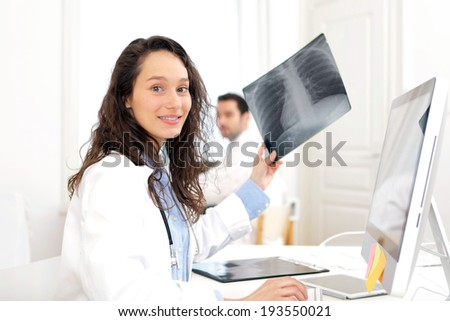 View of a Woman doctor analysing X-ray