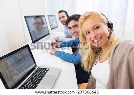 View of a Woman doing selfie with her colleagues - stock photo