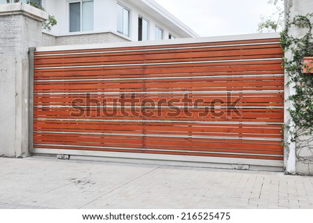 View of a Wooden Gate of a Luxury City Residence - stock photo