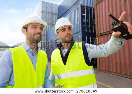 View of a Worker showing to supervisor security system setting up  - stock photo