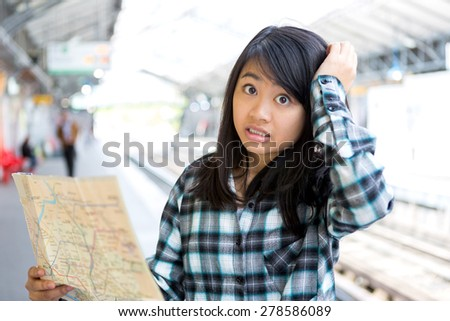 View of a Young attractive asian tourist lost in Paris - stock photo