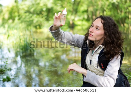 View of a Young attractive biologist woman working on water analysis - stock photo