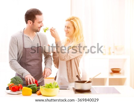 View of a Young attractive couple cooking in a kitchen - stock photo