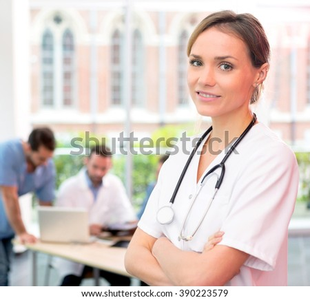 VIew of a young attractive doctor at the hospital